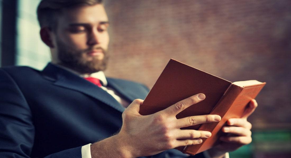 Business-Man-Reading-Book-MBAAndrews